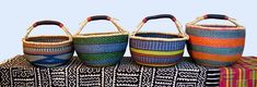 Round Market Baskets : Medium & Large : One leather bound handle Our fair trade baskets are handwoven in the weaving villages around the remote town of Bolgatanga in northern Ghana. Each basket is a unique creation - there is only one! Approximate size, inches: Our medium and large round market baskets range in size from 13-16 inch rim. Important info As our baskets are handwoven, some may vary in shape from those in this image. The close-ups below are of specific baskets showing colour a...