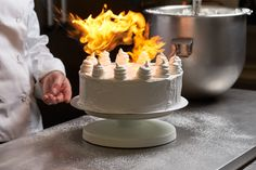 Matbilder food photography of cake being decorated  #matbilder #foodphotography #artisan #advertisingphotography  #lifestylephotography #baking #cooking #cakedecoration #cake #chefworking #icing #flame