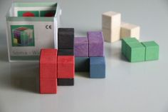 Soma Cube: This classic wooden puzzle has a few interesting challenges in store. Can you build a cube? What about an L-Shape? How many blocks do you need? Cubes, Wooden Puzzles, Pattern Blocks, Toys, Dimensions, Challenges, Shape, Classic, Nature