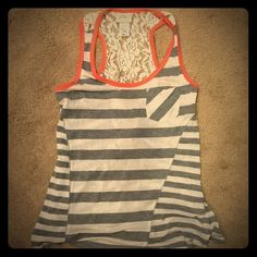 Grey and white striped tank Cute gray and white striped tank. Back is lace, like new Tops Tank Tops