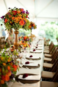 Fall centerpiece on wooden candlestick. Alysha, Uncle greg's dad's wife, has a lot of these tall glass centerpiece vases that would create a look like this if u need them. even if don't like these on main tables maybe use on side tables where food or beverages or whatever is sitting