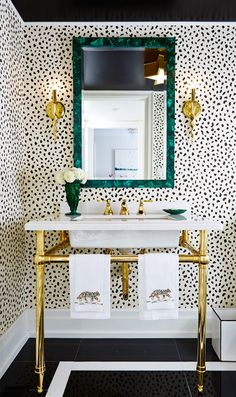 leopard print animal black and white wallpaper for bathroom powder room washroom design diy green mirror marble sink gold legs spots polka dots makeover celebrity home dream bathroom