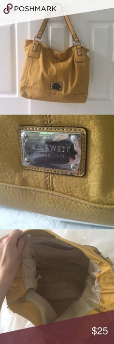 Mustard Nine West Purse Great condition!! Still had the plastic cover over the Nine West plate on the front. Perfect addition to your wardrobe for the summer! Nine West Bags