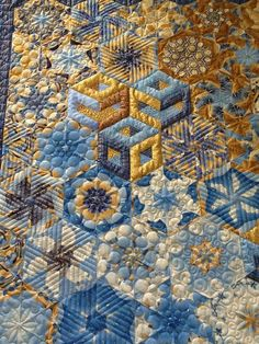 One Block Wonder quilt, quilted by Cecilia Hosford. Featured at Machine Quilting Resource. She used a variety of designs in the hexagons