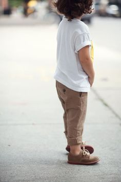 Ryder McNairy. Whata great look for a boy! Chinos rolled up, smooth bucs, and a smiley tee!