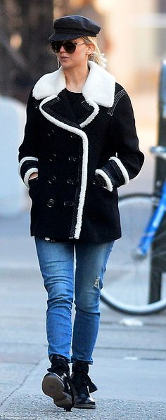 Ever so stylish: Lawrence looked lovely in distressed jeans paired with a black Peacoat wi...
