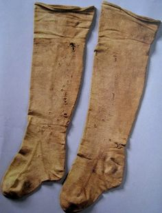 Knitted yellow silk stockings originally belonging to Maria d' Aragona, buried 1568. (San Domenico Maggiore, Naples)