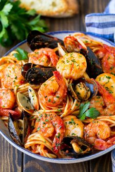 This seafood pasta is a mix of shrimp clams mussels and scallops all tossed together with spaghetti in a homemade tomato sauce. An easy yet elegant meal thats perfect for entertaining! Pastas Recipes, Seafood Pasta Recipes, Fish Recipes, Dinner Recipes, Cooking Recipes, Healthy Recipes, Shrimp Pasta, Pasta Spaghetti, Frozen Shrimp