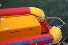 Carbon Index RIB Tubes coloured in Red and Yellow hypalon harlequin pattern with blue bow for Cowes Harbour Patrol Jet RIB Workboat. Harlequin Pattern, Blue Bow, Ribs, Boats, Ships, Pork Ribs, Rib Roast, Prime Rib, Boat