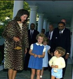 The gold purse was a gift from Emperor Haile Selassie to First Lady Jacqueline Kennedy on the Emperor's first State Visit to the USA. He also gave her a full length leopard coat, and gave carved ivory toys to John John Jr and Caroline.