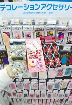 This summer, 'bling'd out' phones and other girly accessories are dominating women fashion trends in Japan -