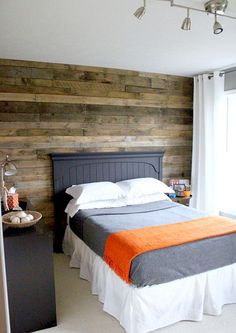 wood pallet wall in guest room.
