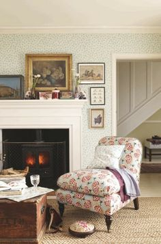 Pomegranate Chair, Emma Bridge/Sanderson Fireplace with black fireplace stove....