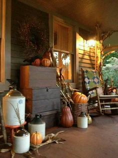 Autumn Porch...with old chests, crocks & rocker.