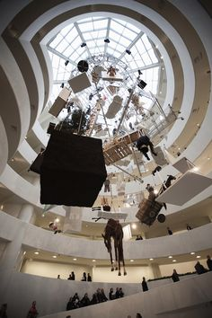 Hanging Sculptures at the Guggenheim by Maurizio Cattelan.