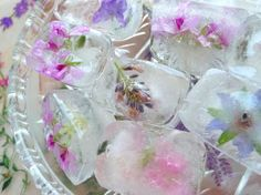 Dress up your drinks with these beautiful and romantic ice cubes featuring blossoms from the garden! Perfect for summer afternoon parties or cocktail events! Pink or red rose petals, use fresh herbs. Flowers and leaves that are suitable include: scented geraniums, nasturtiums, violets, rose petals...