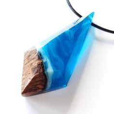 Looks like a stormy 🌊 to us! What do you guys see? . . . #resin #wood #pendant #necklace #handcarved #handmadejewelry #woodenjewelry #wooden #surfer #surfing #jewelrydesign #crystalclear #oceanreef #oceaninspired #bohostyle #bohochic #reef #diving #freediving #bohemian #chicstyle #uniquegift #beachstyle #pendy #pendantsofig #beachin #oceanblue #beachlifestyle #woodallgood