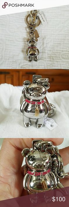 Coach Teddy Bear Key Chain/ Bag Charm Very Rare! Silver Bear, Pink Collar that holds Miniature Gold Tag. Very heavy. Has both clasp to hang on bag & key ring.Chain also adorns silver COACH tag. Two different eyes just like the leather Bears. Simply Adorable🎀 COACH Accessories Key & Card Holders
