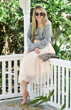 Happy Wednesday! Today I am wearing an oversized cozy sweater with one of my favorite pieces, a tulle midi skirt! I love the pink and grey combo!