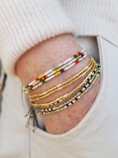 A fun, colorful wrap bracelet in an elegant color pattern made with hundreds of tiny, tiny (1.6 mm!!!) high quality Japanese seed beads. Try it on as an amazing necklace as well! Featherweight and adjustable, it wraps around small to medium wrists 3 times (from around 15 cm/5.9 to 17 cm/6.7, see Beaded Wrap Bracelets, Seed Bead Bracelets, Bracelet Sizes, Seed Beads, Jewelry Gifts, Jewellery, Gifts For Her, Fashion Jewelry, Tiny Tiny