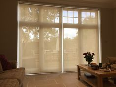 Sunscreen roller blinds fitted to french doors in living room | Haywards Heath, Sussex | Made to measure | Made in UK | Handmade | Modern Blinds | See through blinds | Voile blinds | Shading