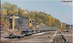 Pittsburgh and Lake Erie GP7s #1501 and #1500 are power for the railroad's local commuter service around Pittsburgh. The train rests on October 19, 1980 as it did not operate during the weekends.