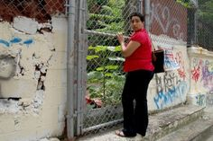 Looking through one of the fences at the old PS. 186 NYC abandoned Schools.