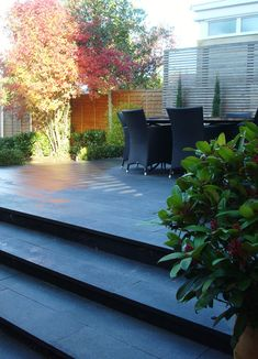 A private garden designed and built by the homeowner using our Blue Grey Granite Plank Paving.