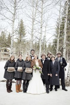 Red hands aren't usually seen as aesthetically pleasing, so hide them in a furry muff. The bridal party seems to love that their hands aren't freezing, while the groomsmen keep their ears warm under their faux fur trapper hats. | Faux Fur Inspiration for Brides and Bridesmaids