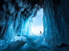 Photograph by Xiao Zhu, National Geographic Your Shot An ice cave beckons on Lake Baikal, the world's oldest and deepest freshwater lake, located in Siberia.