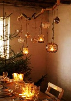 candle light is all around, dancing lights on a bracnh and a natural christms tree