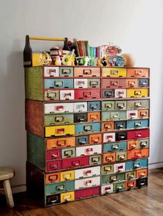 colorful card catalog drawers... don't think I'd do this, but it's a neat look!