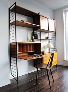 A ladderax shelving unit with pull down writing 'table'