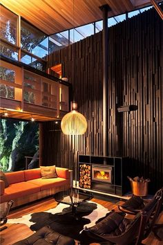 70s inspired design.  Under Pohutukawa is an award-winning beach house designed by Herbst Architects. Home NZ Magazine's Home of the Year, 2012. Located in Piha North in New Zealand. Photographed Patrick Reynolds