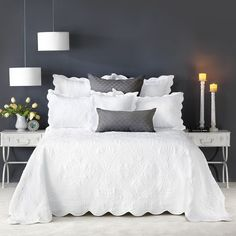 A beautiful bedspread intricately embroidered with a classical motif pattern. The bedspread and pillow shams are trimmed with a scalloped edge. A luxurious bedspread that will be cherished many years to come.