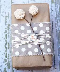 could use lorax wrapping paper with flowers or pom poms!