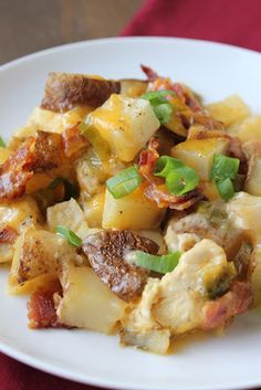 Ingredients 3 - 4 medium russet potatoes, scrubbed and diced (about 1.5 lbs. or 4 1/2 cups) 1 lb. boneless, skinless chicken breasts, diced 4 slices bacon, cooked crisp, cooled and crumbled 1 1/2 cups shredded cheddar cheese 4 green onions, sliced  1/2 teaspoon salt 1/2 teaspoon ground black pepper 1/2 cup heavy cream 2 tablespoons unsalted butter, cut into small pieces