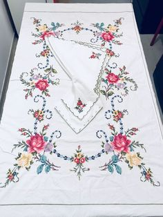 Large very old tablecloth with handmade cross-stitch embroidered roses and its 8 serviettes