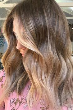 Beige Blonde with Subtle Golden Balayage - neutral blonde gets face-framing golden touches that stretch into ends of hair. The golden shade isn't too yellow or warm, making it perfect for the beige blonde color.