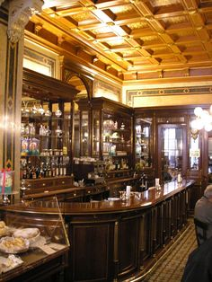 Part of the interior of Demel Café in Vienna, Austria. Viennese cafés have an extremely long and distinguished history that dates back centuries, and the caffeine addictions of some famous historical patrons of the oldest are something of a local legend. Traditionally, the coffee comes with a glass of water. Viennese cafés claim to have invented the process of filtering coffee from booty captured after the second Turkish siege in 1683.