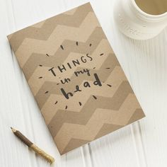 This simple and bold A5 notebook is perfect for jotting down whats in your head! The notebook would make a fantastic and fun stocking filler.This A5 blank notebook has been lovingly illustrated and printed in the UK on to recycled kraft card. The handlettered typographic illustration reads 'things in my head', printed over a chunky chevron pattern. The A5 notebook has 36 blank pages. The things in my head notepad would make a great stocking filler this Christmas.The cover of the notebook is…