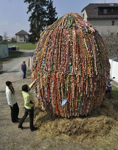 People view the giant record-breaking Easter egg created by 44,858 colored eggs in Bludov, North Moravia, Czech Republic, on Saturday, April 7, 2012. Eggs are hung on 4.2 meters high construction. The last record of this local tradition was 30,658 eggs in 2007.