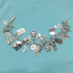 Supernatural Inspired 30 Silver Charms on Stainless Steel Bracelet. | eBay