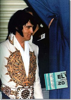 Elvis hits the stage in Charlotte, NC on February 20, 1977.
