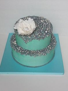 """A birthday cake for a sweet 12 yr old girl - inspired by The Butter End cake - silver pearls, pool blue, jeweled flower -visit me on fb @ """"ihateveggies cakes"""":"""