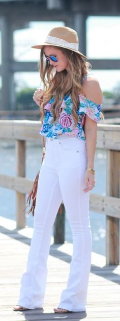 Tropical print crop top paired with white flared jeans for an easy casual summer outfit