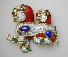 1960s Cartier New York Chinese Lion Dog Coral Gem Set Pin  $48,000