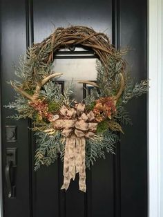 Ooohh, need this minus the bow! Rustic fall or winter wreath with antlers in a grape vine wreath with Green pines.and deer ribbon bow Holiday Wreaths, Holiday Crafts, Christmas Decorations, Holiday Decor, Winter Wreaths, Christmas Centerpieces, Antler Wreath, Hunting Wreath, Deer Antler Crafts