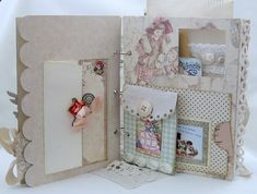 When building a baby scrapbook, or any sort of scrapbook, really...Make pockets and envelopes to hold buttons, fabrics, cards, and other small bits of memories~!