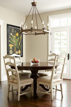 ML Interior Design - Round dark traditional table updated by white glazed chairs